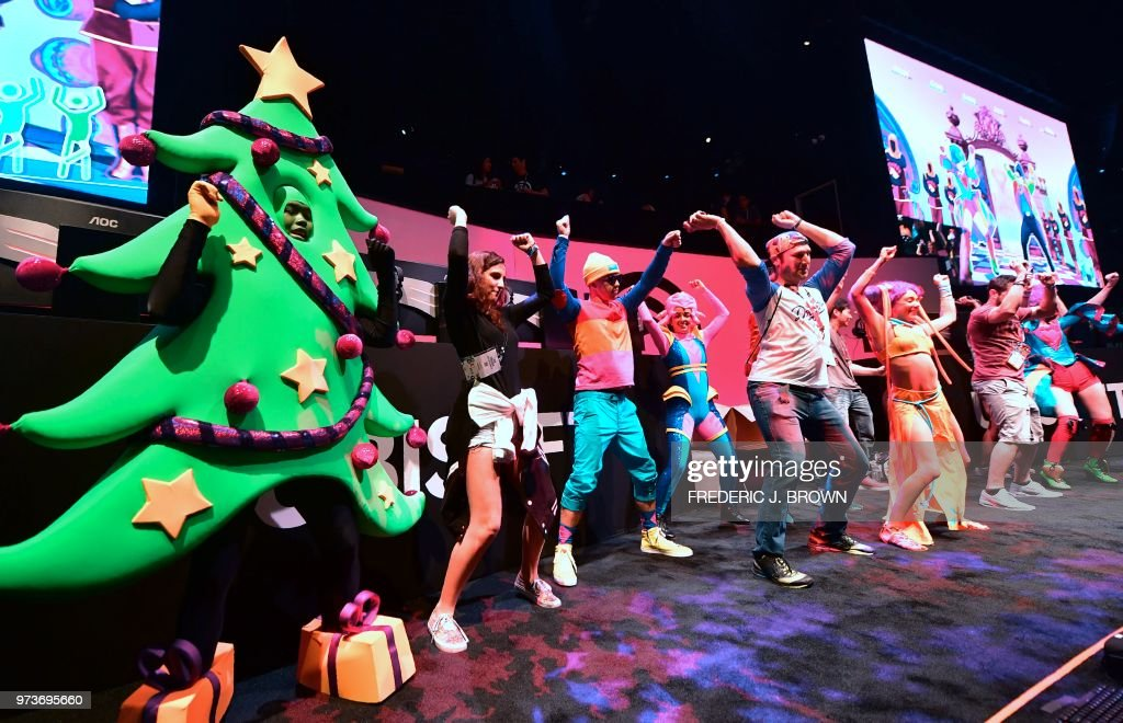 Dancers work out to Ubisoft\'s Just Dance 2019 at the 24th Electronic ...