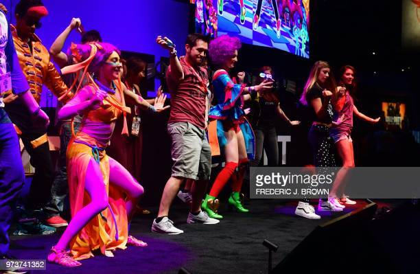 Dancers work out to Ubisoft's 'Just Dance 2019' at the 24th Electronic Expo or E3 2018 in Los Angeles California on June 13 where hardware...