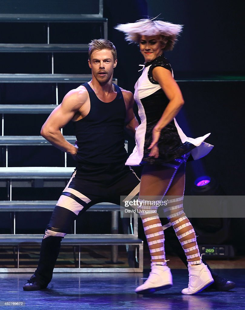 Dancers/TV personalities Derek Hough (L) and Julianne Hough perform on stage during the Move Live on Tour production at the Orpheum Theatre on July 26, 2014 in Los Angeles, California.