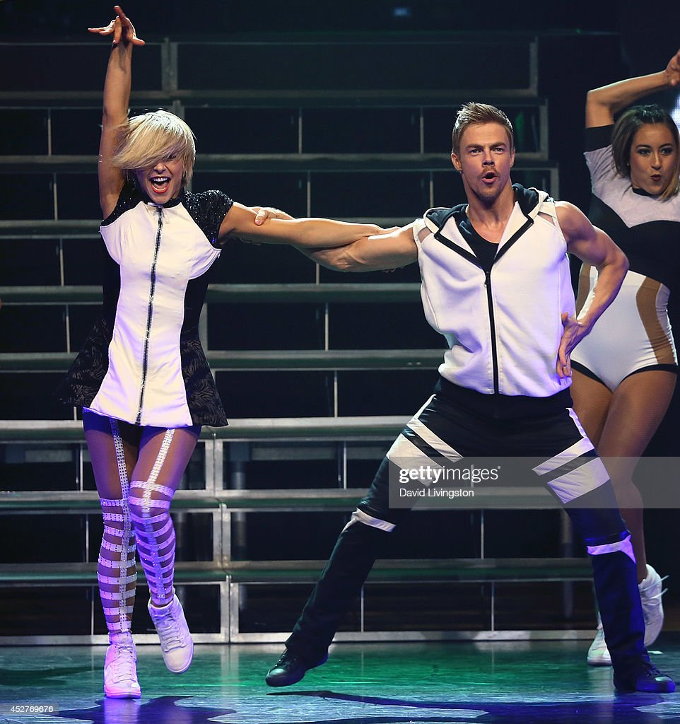 Dancers/TV personalities Julianne Hough (L) and Derek Hough perform on stage during the Move Live on Tour production at the Orpheum Theatre on July 26, 2014 in Los Angeles, California.
