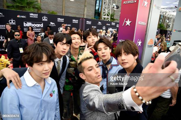 DancerTV personality Frankie Grande takes a selfie with musical group BTS at the 2018 Billboard Music Awards at MGM Grand Garden Arena on May 20 2018...