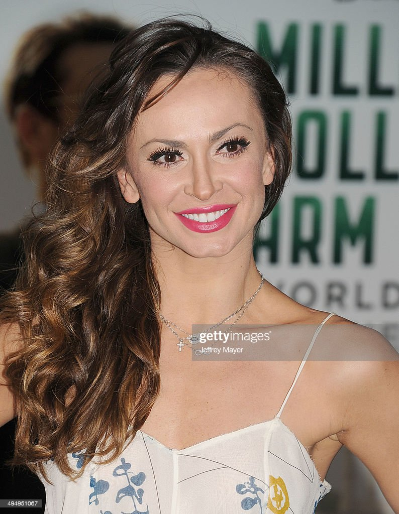Dancer/TV personality Karina Smirnoff arrives at the Los Angeles premiere of 'Million Dollar Arm' at the El Capitan Theatre on May 6, 2014 in Hollywood, California.