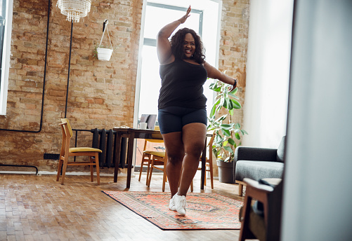 Dancing alone always makes me happy stock photo 1215132745