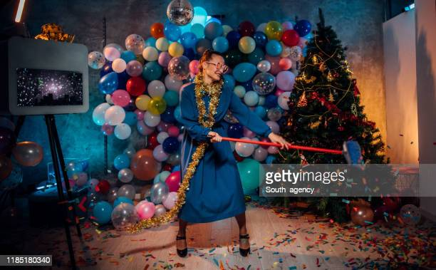dancing and cleaning after new year party - clean up after party stock pictures, royalty-free photos & images
