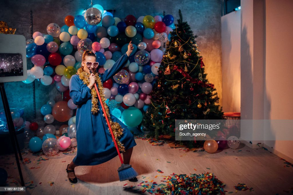 Dancing and cleaning after new year party : Stock Photo