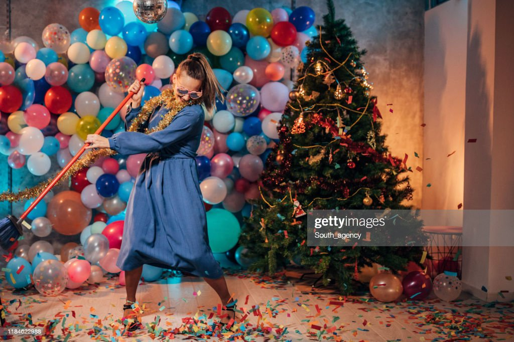 Dancing and cleaning after party : Stock Photo