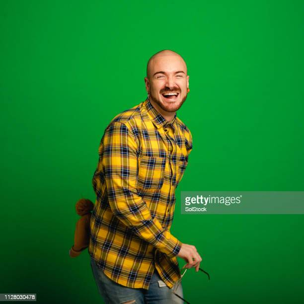 dancing and laughing - green background stock pictures, royalty-free photos & images