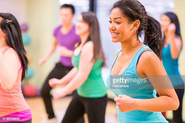 dancing at a fitness class in the gym - black cheerleaders stock photos and pictures