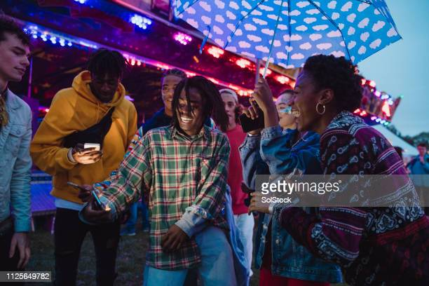 dancing at a funfair - music festival stock pictures, royalty-free photos & images