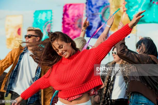 dancing at a music festival - music style stock pictures, royalty-free photos & images