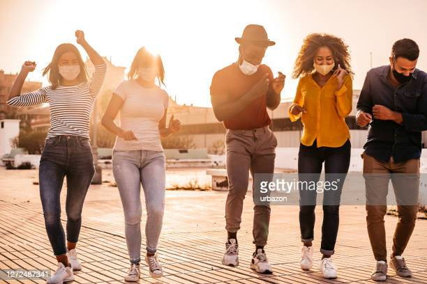 dancing at dawn - celebratory event stock pictures, royalty-free photos & images