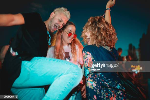 dancing at outdoor music festival - generation z stock pictures, royalty-free photos & images