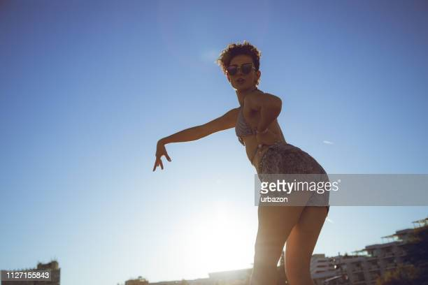dancing at the beach - salsa dancing stock photos and pictures