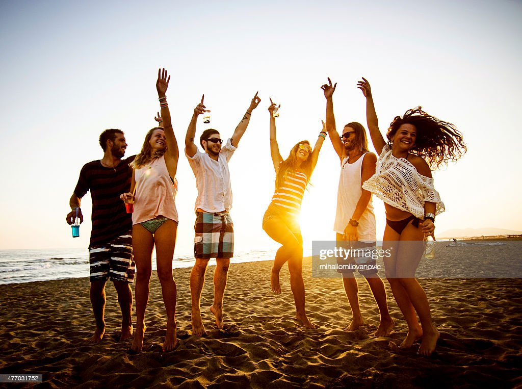 Dancing at the beach : Stock Photo