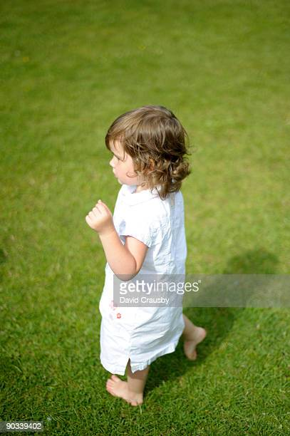 dancing barefoot girl in white dress - crausby stock pictures, royalty-free photos & images