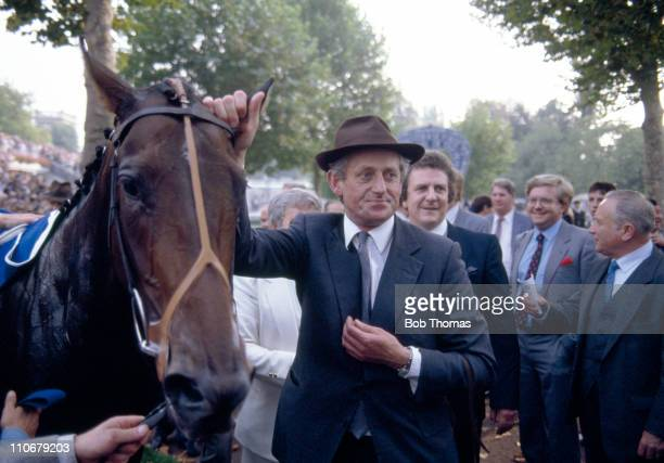 Dancing Brave with trainer Guy Harwood after winning the Prix de l'Arc de Triomphe at Longchamp on 5th October 1986