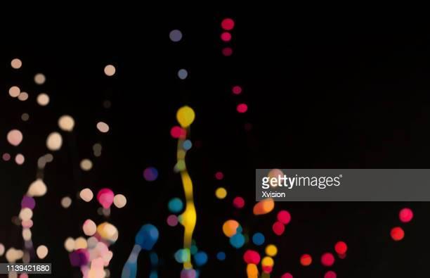 dancing color with black background - rebote fotografías e imágenes de stock