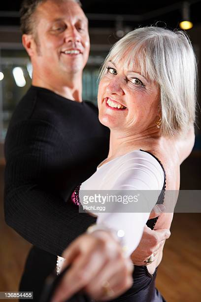 dancing couple - gewalt stockfoto's en -beelden