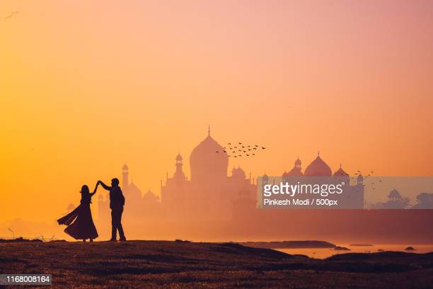 dancing couple - the tajmahal - agra stock pictures, royalty-free photos & images