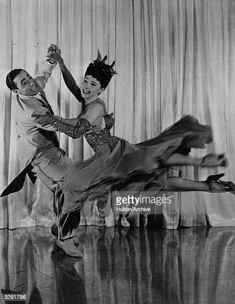 Dancing couple Tony and Sally De Marco perform a daring spin in a scene from the 20th Century Fox music and dance extravaganza 'Greenwich Village',...