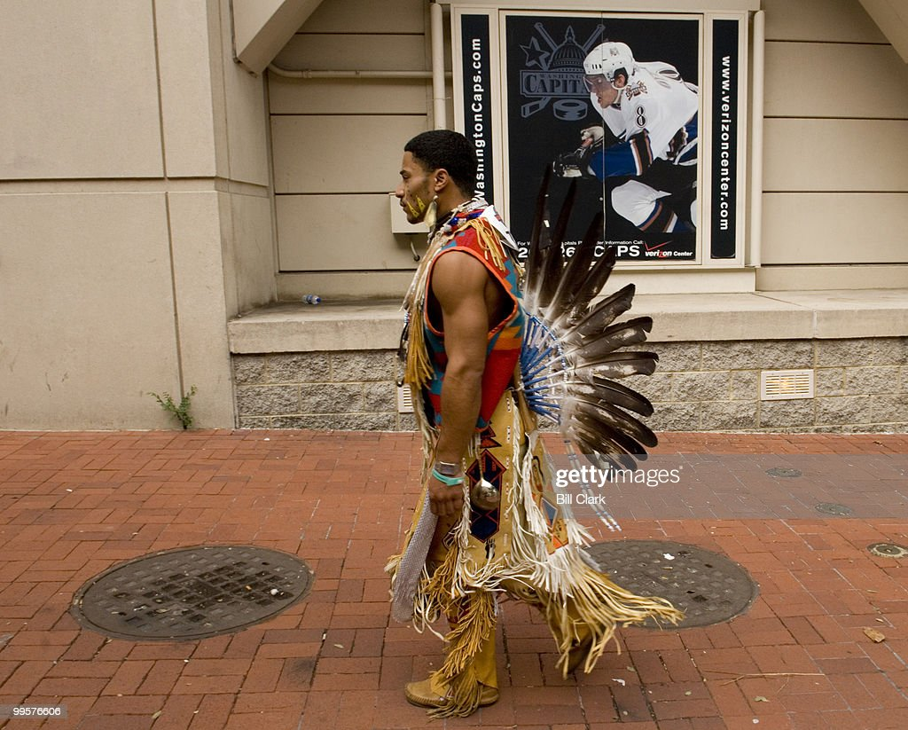 P.J. Dancing Eagle Frye, of the Wampanoag tribe of Cape Cod. Mass., walks outside of the Verizon Center in Washington as the National Powwow gets underway inside on Friday, Aug. 10, 2007. The 3-days of drumming and dancing is organized by the Smithsonian National Museum of the American Indian.