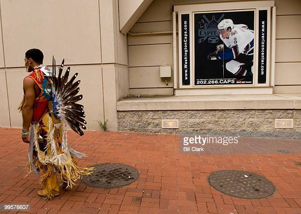 J Dancing Eagle Frye of the Wampanoag tribe of Cape Cod Mass walks outside of the Verizon Center in Washington as the National Powwow gets underway...