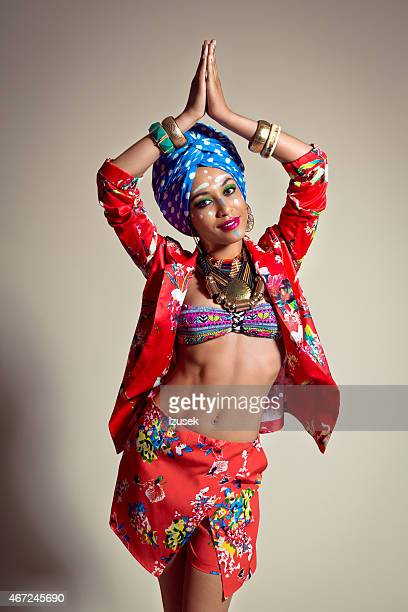 dancing exotic young woman wearing blue turban - crazy holiday models stock photos and pictures