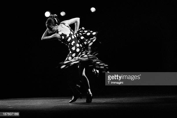 dancing flamenco lunares - flamenco dancing stock photos and pictures