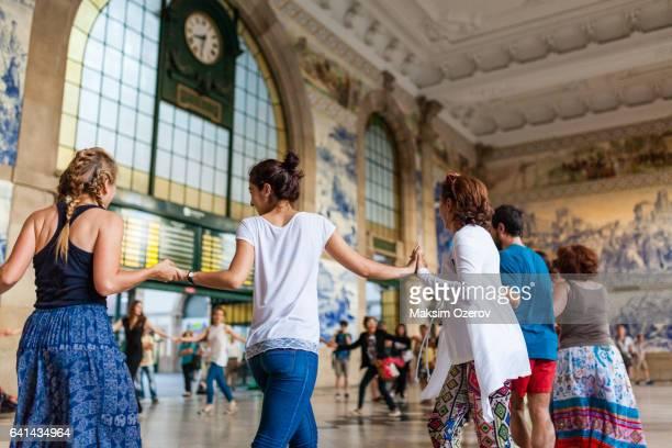 Dancing flashmob at Sao Bento Railway station in Porto