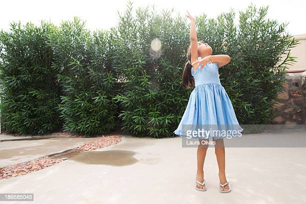 Dancing Girl in Blue Dress