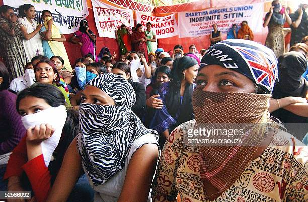 Dancing girls who perform in liquor bars cover their faces at a protest rally against the state government in Bombay04 April 2005 The government of...