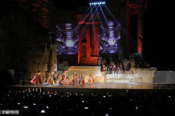 A dancing group performs during the opening of the Baalbek international festival in Lebanon's eastern Bekaa Valley on July 7 2017 / AFP PHOTO /...