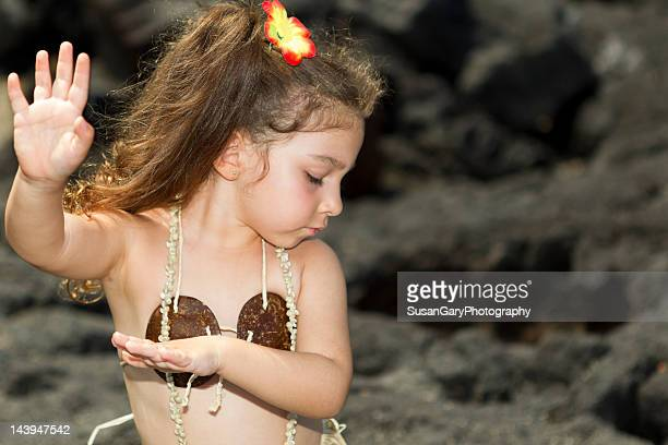 Dancing hula girl on black volcanic rock