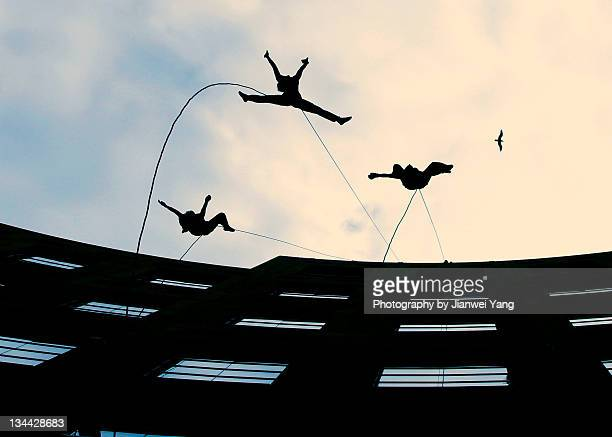dancing in air - dance troupe stock photos and pictures