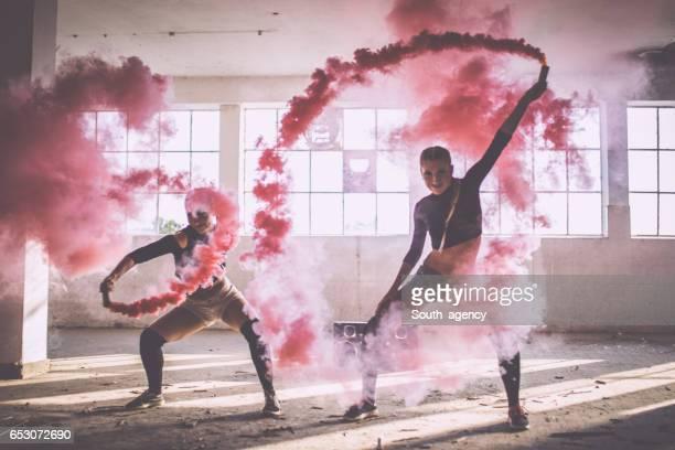 Dancing in pink smoke