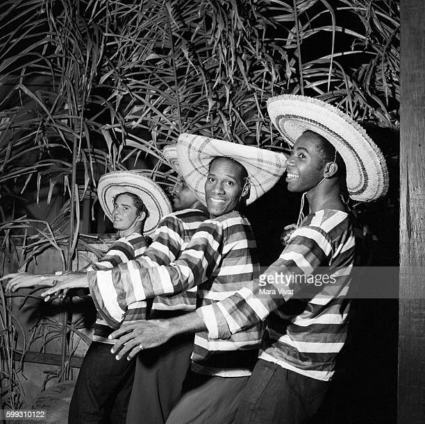 Dancing in Striped Shirts and Straw Hats