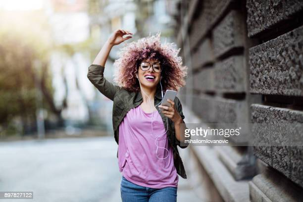 dancing in the city streets - happy stock photos and pictures