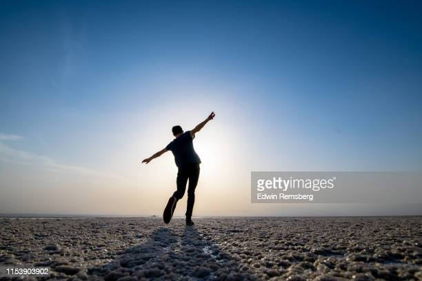 dancing into the sunset - climate stock pictures, royalty-free photos & images