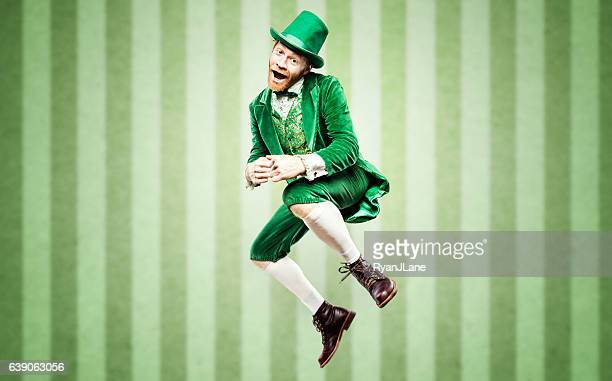 dancing leprechaun man on st. patricks day - st patricks stock pictures, royalty-free photos & images