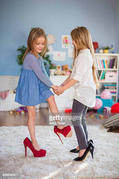 dancing like they were adults. debica, poland - little girl in high heels stock photos and pictures