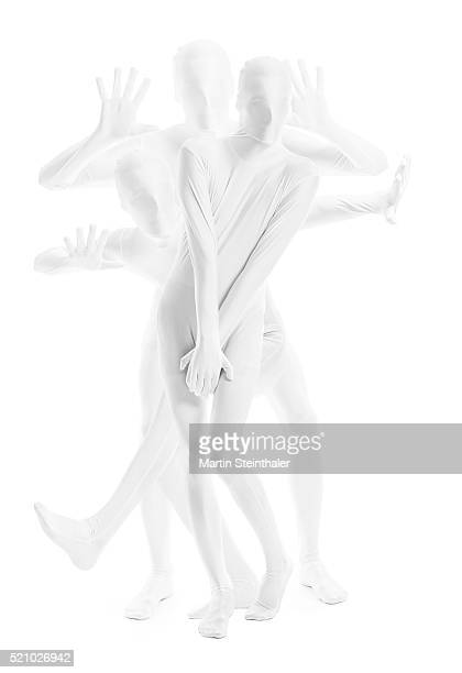 dancing man in white morphsuit - bodysuit stock pictures, royalty-free photos & images