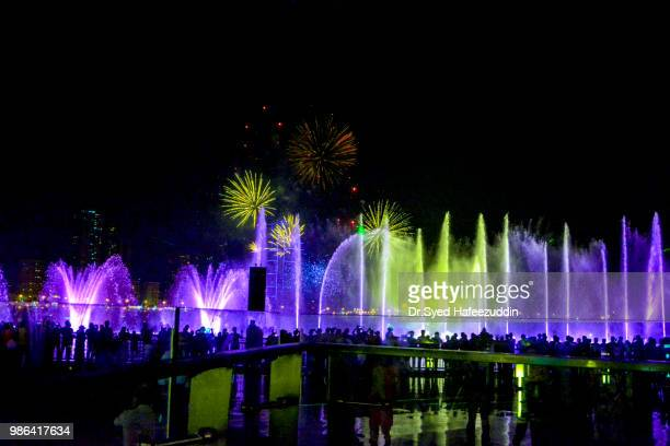 dancing musical fountains and fireworks - national landmark stock pictures, royalty-free photos & images