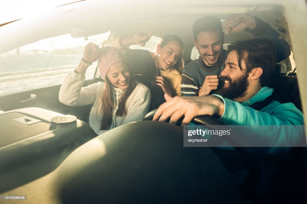 Dancing on a road trip in the car! : Stock Photo