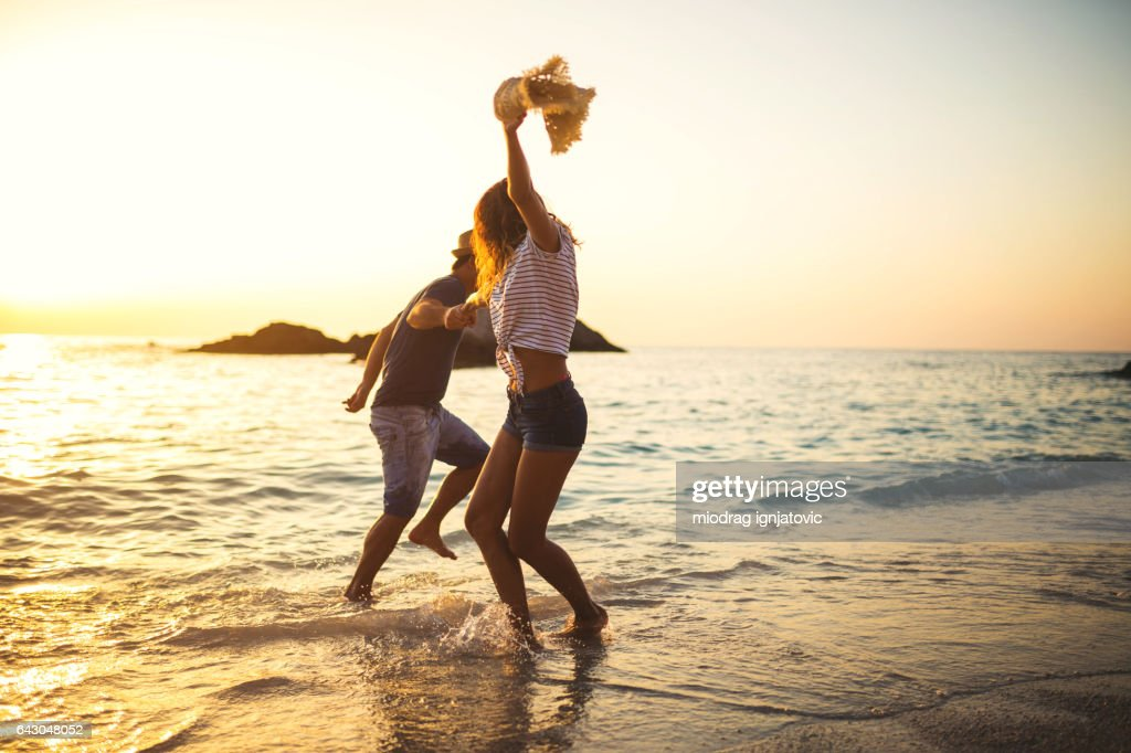 Dancing on the beach : Stock Photo