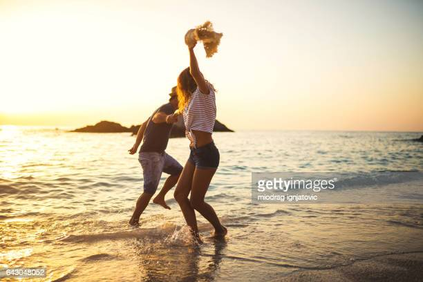 dancing on the beach - beach stock pictures, royalty-free photos & images