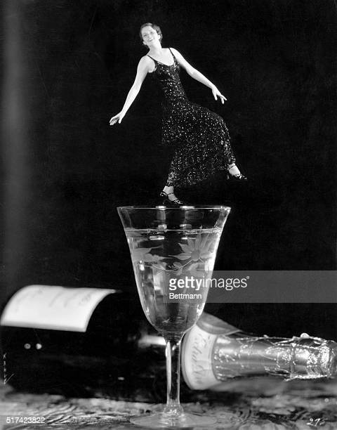 Dancing on the brim of a glass seems like precarious fun but not when Marguerite Churchill does it with the help of the Fox Film cameraman Thus read...