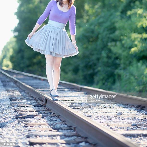 dancing on the railway - purple skirt stock pictures, royalty-free photos & images