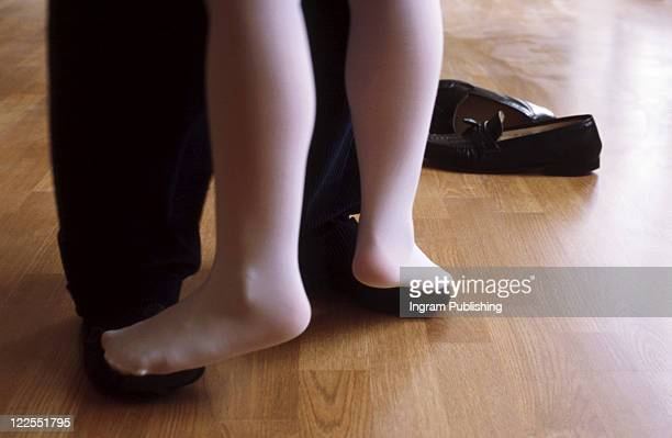 dancing on their feet - nylon feet stock photos and pictures