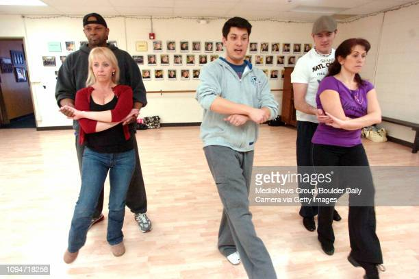 Dancing partners from left Joanie Brousseau with De Thomas and Ali Dunfee with Brian Jackson follow Choreographer Matthew D Peters in some dance...
