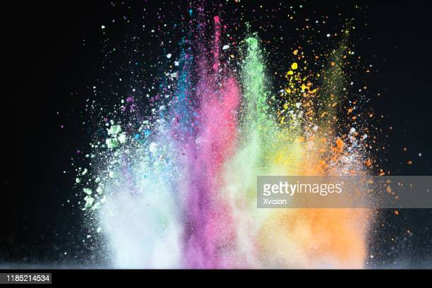 dancing powder color with black background captured with high speed sync. - slow motion stock pictures, royalty-free photos & images